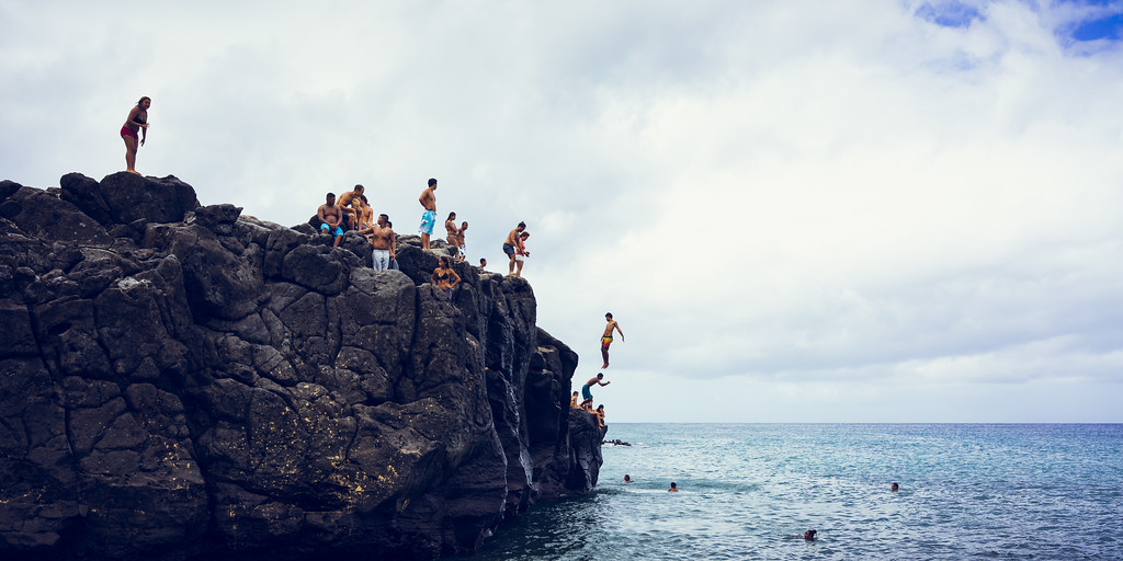 Jumping the Waimea Bay rocks in Oahu Hawaii.