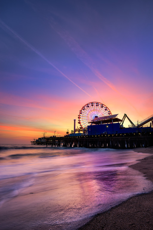 The Santa Monica Pier during a colorful southern California sunset.